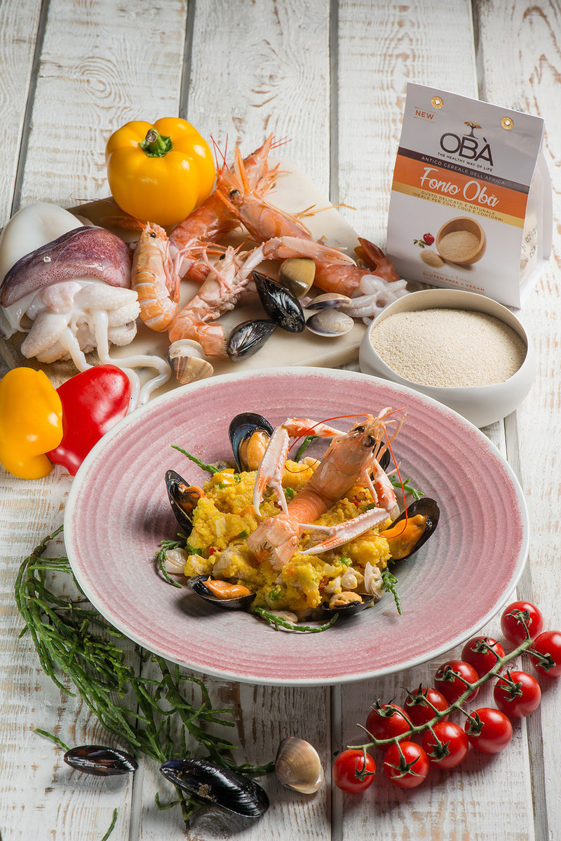 Seafood, meat and Fonio paella